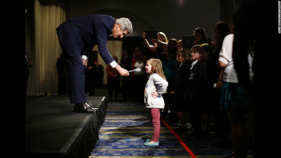 U.S. Secretary of State John Kerry speaks with Dara Edwards, the 5-year-old daughter of an American staff member at the U.S. Consulate in Sydney, as he met with embassy and consular staff there on Tuesday, August 12.