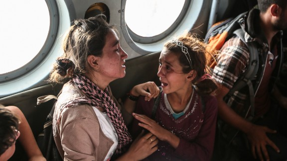 Aziza Hamid, a 15-year-old Iraqi girl, cries for her father while she and other Yazidi people are flown to safety after a dramatic rescue operation at Iraq's Mount Sinjar on August 11, 2014. A CNN crew was on the flight, which took diapers, milk, water and food to the site where as many as 70,000 people were trapped by ISIS. Only a few of them were able to fly back on the helicopter with the Iraqi Air Force and Kurdish Peshmerga fighters.