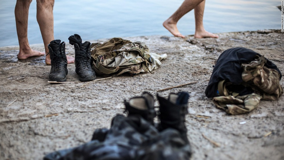 "Clothes of some Ukrainian soldiers are placed nearby as they swim in a lake after fighting militants near Donetsk, Ukraine, on Friday, August 8. For months, Ukrainian government forces <a href=""http://www.cnn.com/2014/08/07/europe/gallery/ukraine-crisis/index.html"">have been fighting pro-Russian separatists</a> near the Russia border. The fighting has left more than 2,000 people dead since mid-April, according to ""conservative"" estimates from United Nations officials."