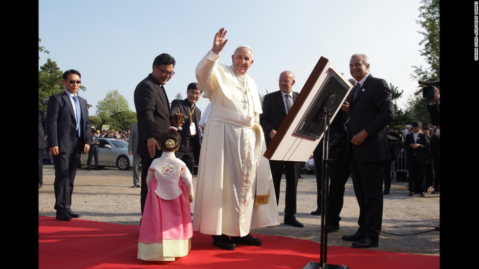 Pope Francis waves to a crowd during his visit to the birthplace of Saint Kim Taegon Andrea, who was the first Korean-born Catholic priest and is the patron saint of Korea, at the Solmoe Shrine for Korea's Catholic martyrs on August 15.
