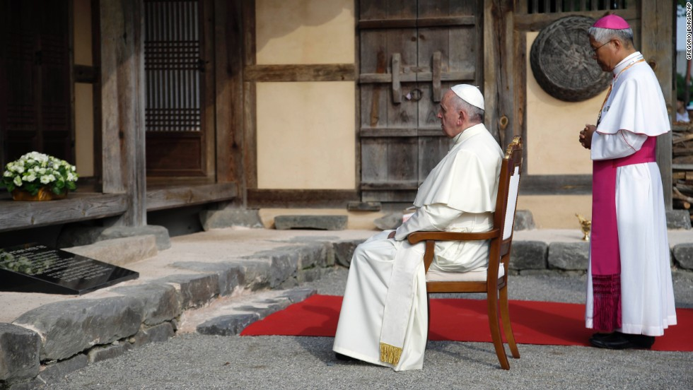 Pope Francis prays with Daejeon Bishop Lazarus You Heung-sik in front of the birthplace of Saint Andrea Kim Dae-gun in Dangjin.