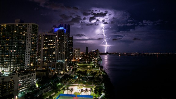 """I was really surprised I was able to capture a lightning strike like this,"" said Madeline Belt, who shot this photo off Biscayne Bay in Miami in June. The storm would later become Hurricane Arthur."