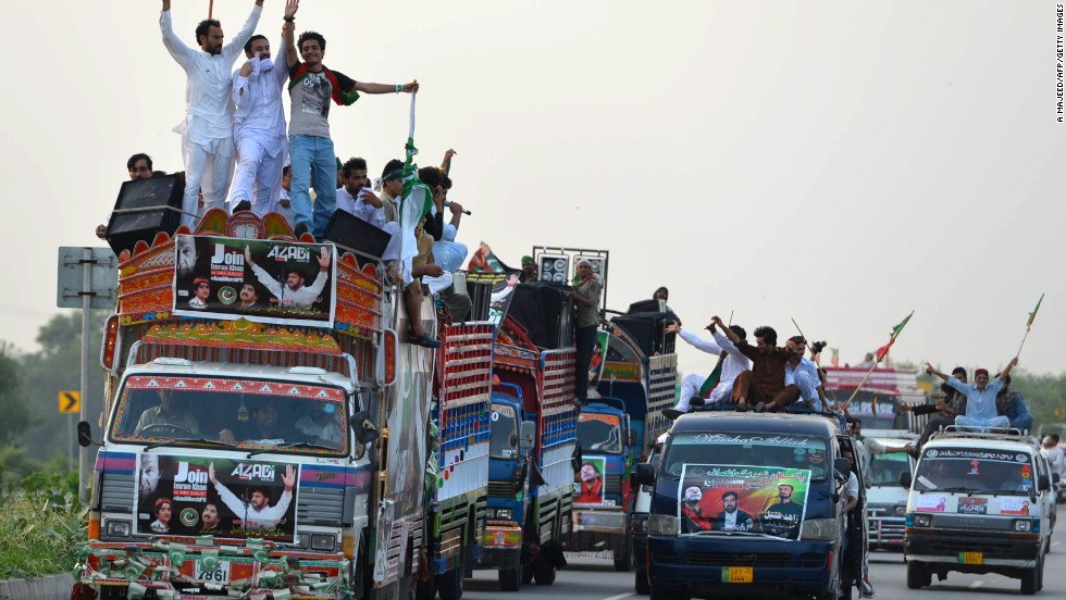 Supporters of opposition leader Imran Khan travel past Swabi on August 14, as they journey towards Islamabad for an anti-government rally.