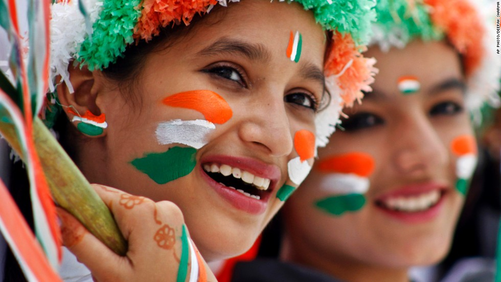 AUGUST 15 - AJMER, INDIA: Schoolgirls dressed in the colors of the Indian flag participate in rehearsals for Independence Day celebrations. The 68th annual event marks the country's freedom from British rule on this day in 1947.