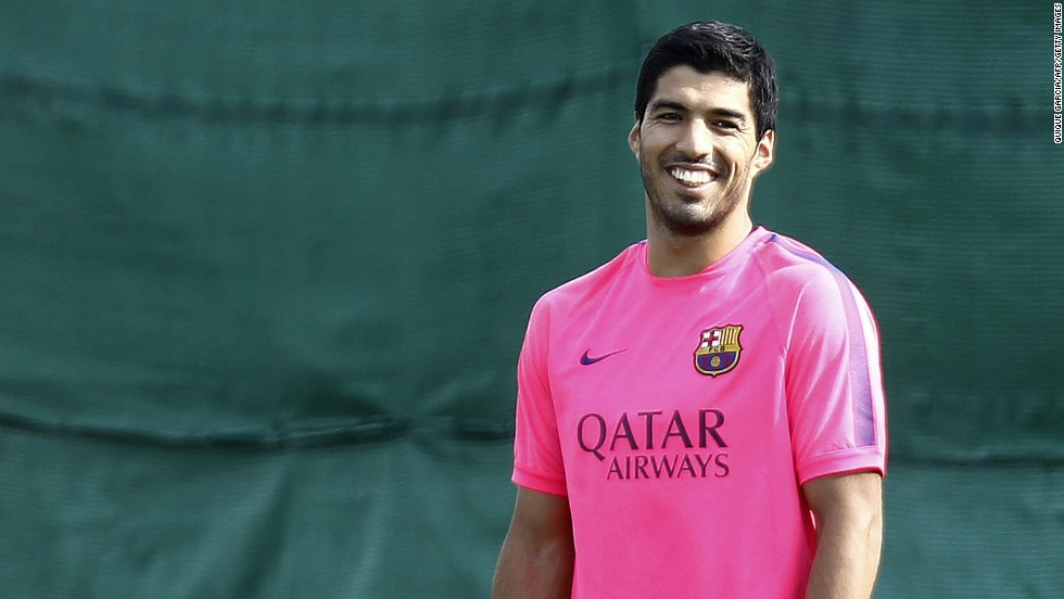 Suarez was in good spirits during the Friday training session at Barcelona's training ground and will be feeling flush too thanks to a reported $330,000 per week, five-year deal he has signed with the Spanish football giant.