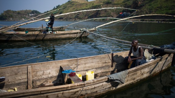 """What these tourists may not know, however, is that because of the area's volcanoes and anaerobic bacteria in the water, Lake Kivu is a storehouse for 60 billion cubic meters of methane gas, and susceptible to underwater eruptions. It is one of three """"exploding lakes"""" in the world."""