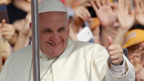 Pope Francis gives a thumbs-up sign during a visit to South Korea in August 2014.