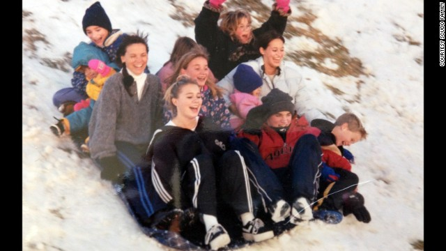 Cynthia Scudo sleds with all of her eight children.