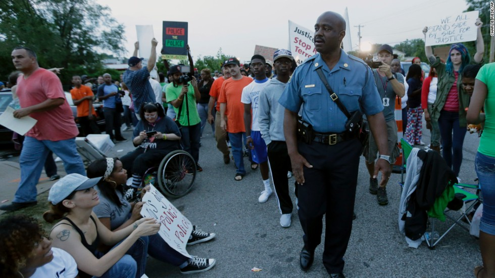 HIghway Patrol Capt. Ron Johnson, who grew up near Ferguson, MIssouri, was credited with helping to calm the racial unrest that erupted there in August following the fatal police shooting of an unarmed black teenager. Johnson even took the unusual step of marching with protesters upset about Michael Brown's death.