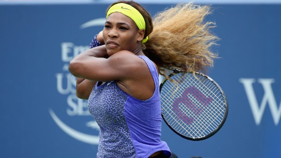 "With her hair -- which she once described as ""super crazy"" -- tied back, Serena blasts a shot in a match against Ana Ivanovic in Cincinnati."