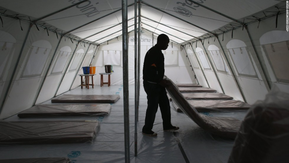 Workers prepare the new Ebola treatment center on August 17, 2014.