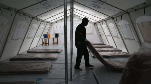 Workers prepare the new Doctors Without Borders Ebola treatment center on August 17.