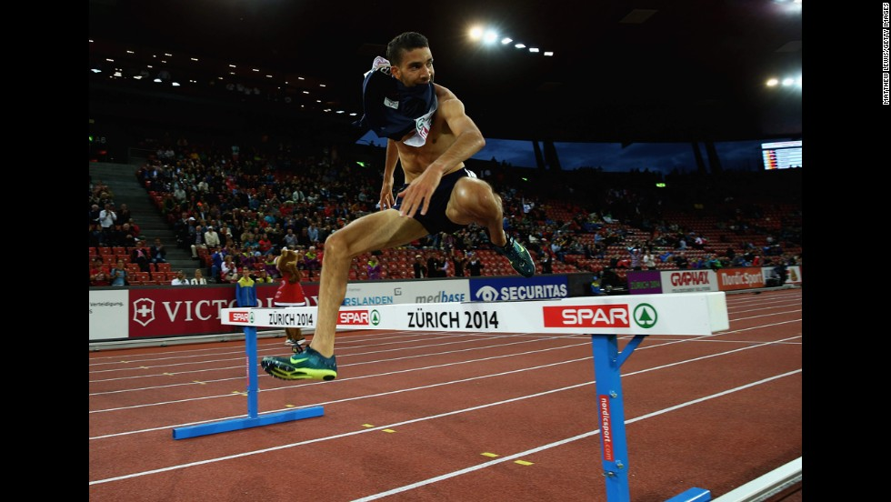 "France's Mahiedine Mekhissi-Benabbad leaps over the final barrier on his way to winning the 3,000-meter steeplechase final Thursday, August 14, at the European Athletics Championships in Zurich, Switzerland. But <a href=""http://www.cnn.com/2014/08/14/sport/athletics-mekhissi-benabbad-vest-gold/"">he was later disqualified</a> for his shirtless celebration in the last stretch of the race."