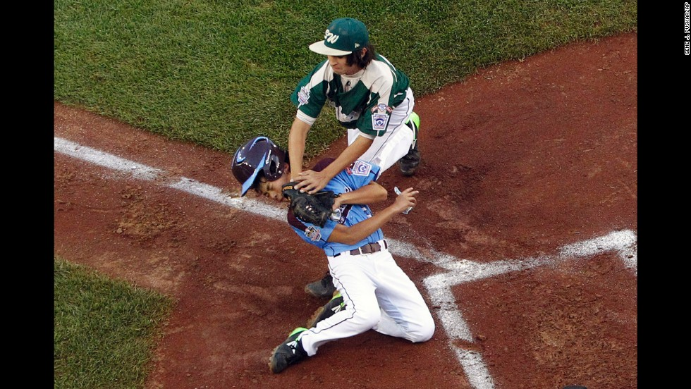 Philadelphia's Jack Rice is tagged out at home by Pearland, Texas, pitcher Clayton Broeder during a Little League World Series game Sunday, August 17, in South Williamsport, Pennsylvania. Philadelphia advanced to the third round of the U.S. bracket with a 7-6 victory.