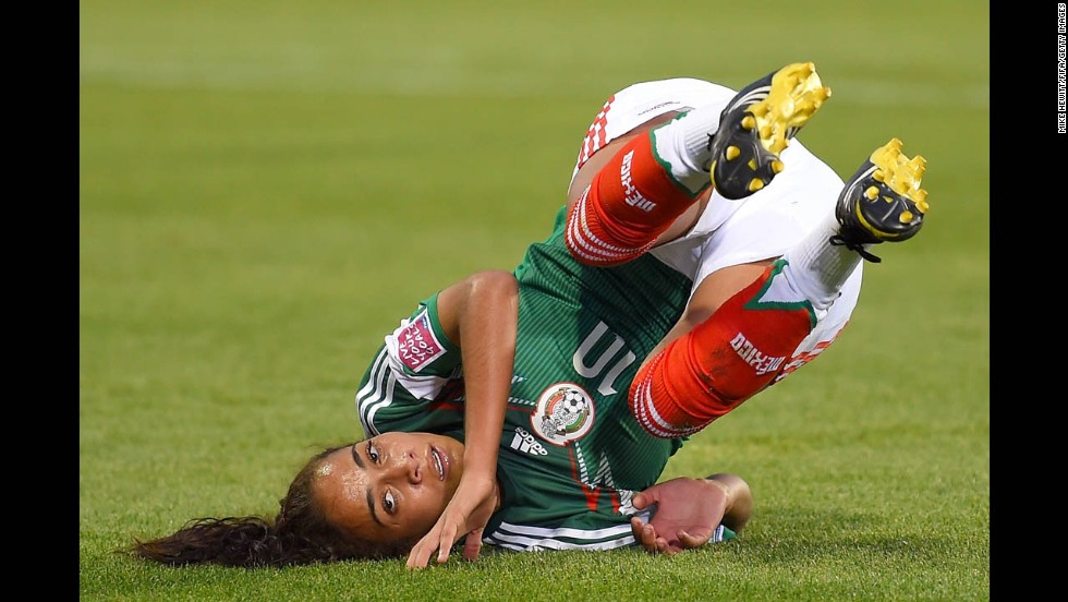 Carolina Jaramillo of Mexico falls to the field Wednesday, August 13, after missing a chance to score against South Korea during the U-20 Women's World Cup in Canada. South Korea won 2-1 to advance out of the group stage and eliminate Mexico.