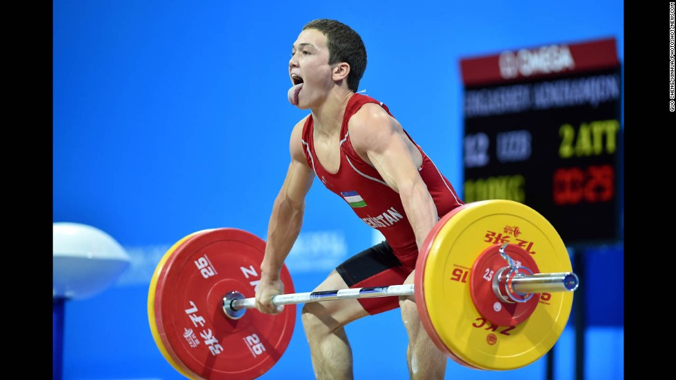 Uzbek weightlifter Adkhamjon Ergashev competes Sunday, August 17, at the Youth Olympic Games in Nanjing, China. He won bronze in his weight category.