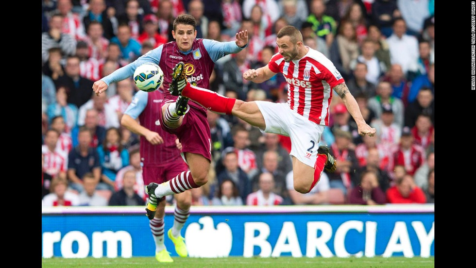 "Stoke City's Phil Bardsley, right, challenges Aston Villa's Ashley Westwood during their Premier League match Saturday, August 16, in Stoke-on-Trent, England. Aston Villa won 1-0. <a href=""http://www.cnn.com/2014/08/12/worldsport/gallery/what-a-shot-0812/index.html"">See 30 amazing sports photos from last week</a>"