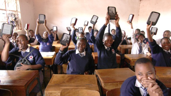 "Academy students show off their Kindle e-readers. ""The Kindle is very important,"" said Abdul Kassim, the school's founder and executive director. ""It means their life."""