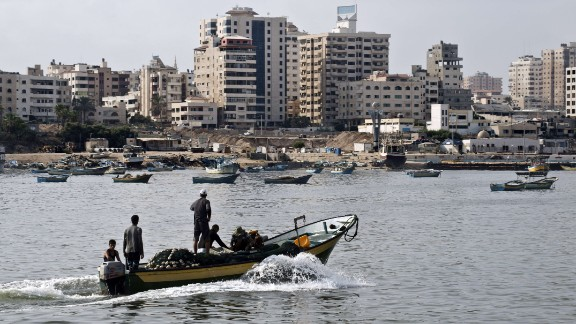 Fishermen ride a small boat into the harbour on August 18, 2014 in Gaza City. Egyptian-brokered indirect negotiations between Israel and the Palestinians are taking place in Egypt during a five-day lull in the fighting that is due to expire at midnight (2100 GMT). Hamas, the defacto rulers of the impoverished enclave, want a firm Israeli commitment to end the blockade of Gaza and demand an airport in the coastal strip. AFP PHOTO/ROBERTO SCHMIDTROBERTO SCHMIDT/AFP/Getty Images