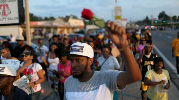 FERGUSON, MO - AUGUST 18: Demonstrators protesting the shooting death of Michael Brown make their voices heard on August 18, 2014 in Ferguson, Missouri. Protesters have been vocal asking for justice in the shooting death of Michael Brown by a Ferguson police officer on August 9th. (Photo by Joe Raedle/Getty Images)