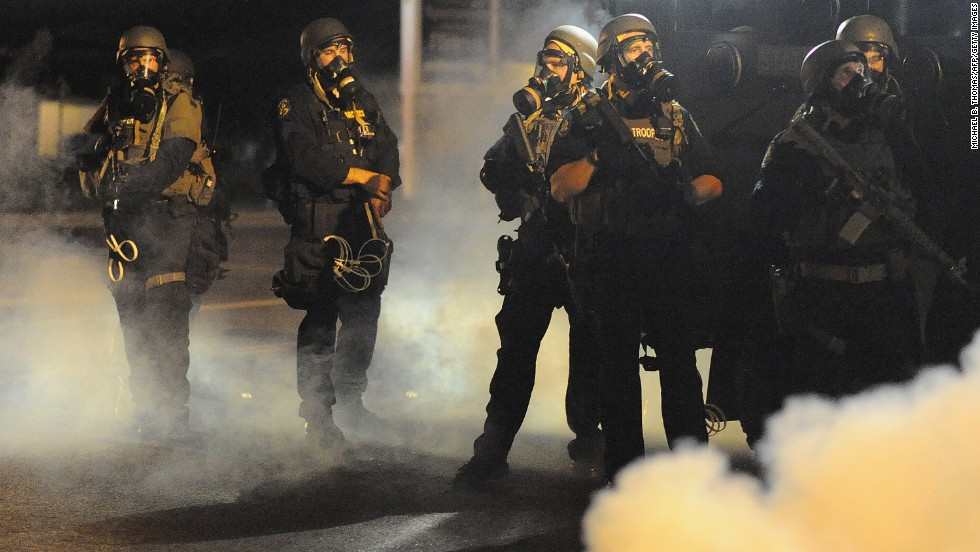 Law enforcement officers stand guard during a protest on West Florissant Avenue on August 18, 2014.