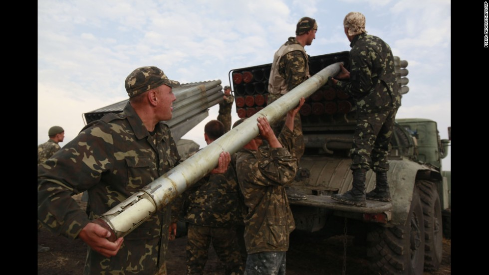 Ukrainian soldiers load a missile during fighting with pro-Russian rebels Monday, August 18, near Luhansk.