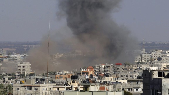 Smoke billowS following an Israeli air strike in Rafah in the southern of Gaza Strip, on August 19, 2014. Israel carried out at least four air strikes across Gaza and ordered its negotiating team back from truce talks in Cairo after three rockets hit the country's south. AFP PHOTO / SAID KHATIB (Photo credit should read SAID KHATIB/AFP/Getty Images)