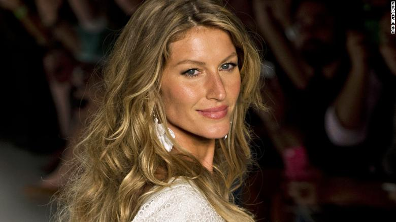 Brazilian supermodel Gisele Bundchen presents a creation by Colcci during the 2015 Summer collections of the Sao Paulo Fashion Week in Sao Paulo, Brazil, on April 2, 2014. AFP PHOTO / Nelson ALMEIDA        (Photo credit should read NELSON ALMEIDA/AFP/Getty Images)