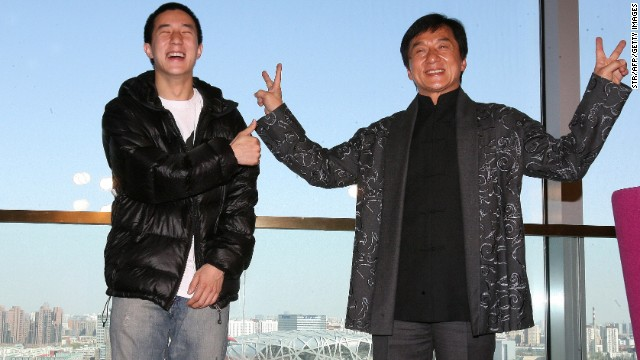 "Jackie Chan (right) poses with his son Jaycee in 2009 outside Beijing's ""Bird's Nest"" olympic stadium."