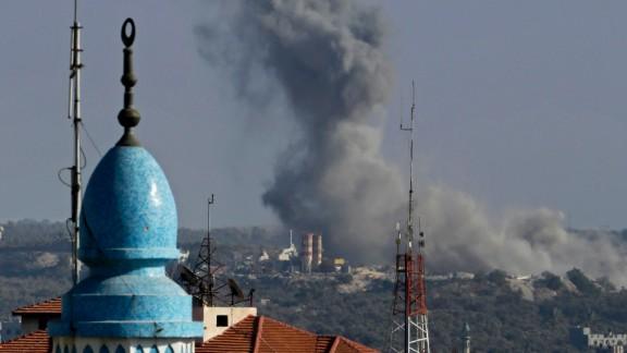 Smoke rises after an Israeli strike hit Gaza City on August 19, 2014.