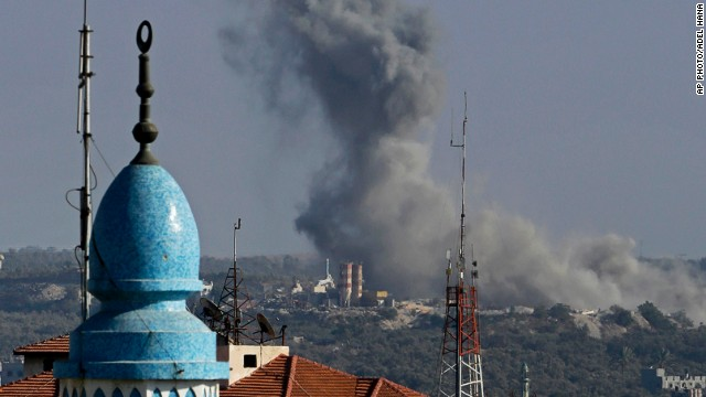 Smoke rises after an Israeli strike hit Gaza City on August 19, 2014.