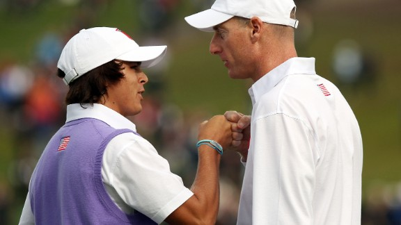 Fowler partnered veteran Jim Furyk in his first match, but committed a schoolboy error on hole two when he took a drop from the mud but used a different ball to the original, costing the U.S. the hole. He made up for that with a putt on the last to rescue a half from the match.