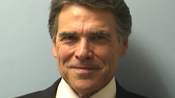 Perry was booked on August 19, 2014, on two felony charges related to his handling of a local political controversy. He vowed to fight the charges.