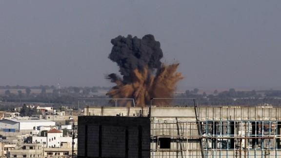 Smoke billowS following an Israeli air strike in Rafah in the southern of Gaza Strip, on August 19, 2014.