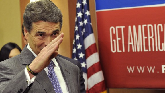 Perry salutes after announcing on January 19, 2012, that he's suspending his presidential campaign just days before South Carolina's GOP primary.  Perry finished sixth in the New Hampshire primary earlier that month.