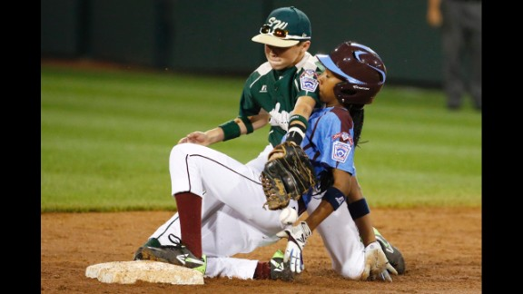 Davis is safe at second in the August 17 match against Pearland. An estimated 32,000-plus people showed up to watch Davis play in South Williamsport, Pennsylvania, after her shutout gained national attention.