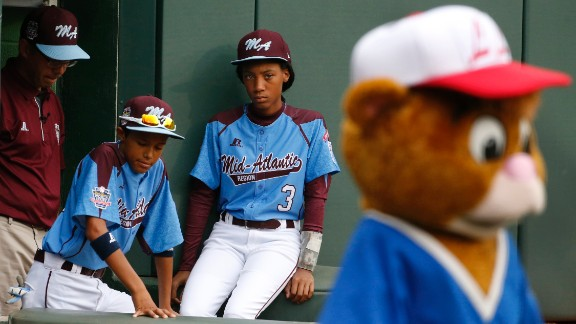 """Sports Illustrated writer Albert Chen says of the 13-year-old phenom in his cover story: """"She's a lot of things to a lot of different people, all of them good things: a totem for inner-city baseball, a role model for your 10-year-old niece, a role model for your 10-year-old nephew."""""""