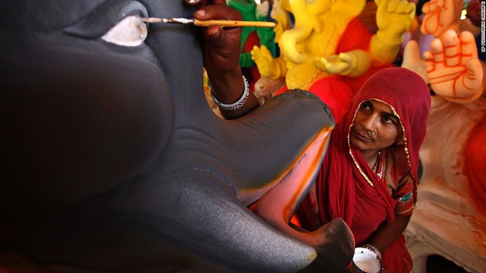 AUGUST 20 - CHENNAI, INDIA: An artisan adds finishing touches to an idol of the elephant-headed Hindu God Ganesh at a workshop on the outskirts of Chennai on August 19. The idols are being prepared ahead of the Ganesh Chaturthi festival that celebrates the birthday of the God.