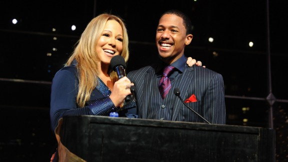 """The couple shared a love of the holiday season. Here, they speak at the listening party for Carey's holiday album """"Merry Christmas II You"""" in 2010 in New York."""