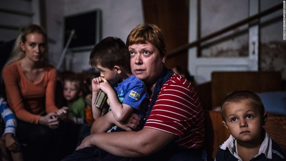 "Children and their teachers hide in a bomb shelter at an orphanage in Makiyivka, Ukraine, on Tuesday, August 19. For months, Ukrainian government forces <a href=""http://www.cnn.com/2014/08/07/europe/gallery/ukraine-crisis/index.html"">have been battling pro-Russian rebels</a> near Ukraine's eastern border with Russia. The fighting has left more than 2,000 people dead since mid-April, according to estimates from United Nations officials."