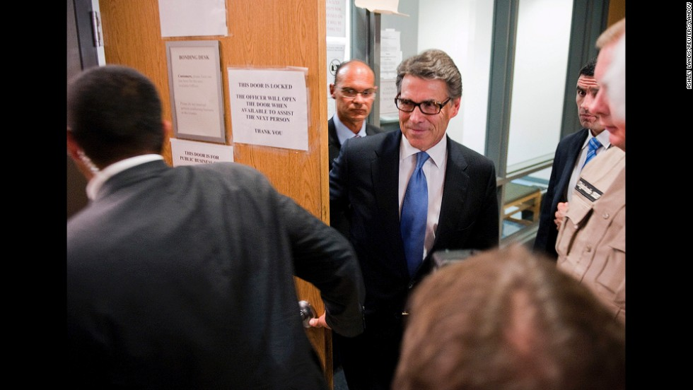 "Texas Gov. Rick Perry leaves the booking area at the Travis County Courthouse in Austin, Texas, on Tuesday, August 19. He was <a href=""http://www.cnn.com/2014/08/19/politics/perry-indictment-booked/index.html"">charged with two felony counts</a> related to his handling of a local political controversy. Perry and his team of lawyers are framing the indictment as a political attack. ""I'm going to enter this courthouse with my head held high knowing that the actions I took were not only lawful and legal but right,"" Perry told reporters."
