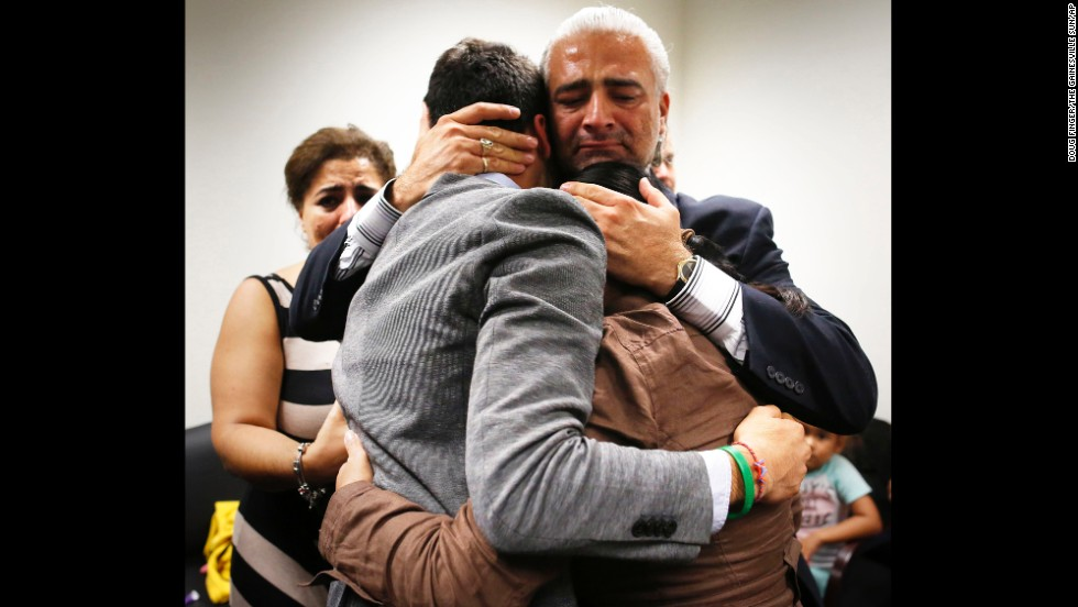 Diego Aguilar, the uncle of slain college student Christian Aguilar, hugs Christian's younger brother, Alex, in a Gainesville, Florida, courtroom Friday, August 15, after Pedro Bravo was found guilty of murdering Aguilar in 2012.