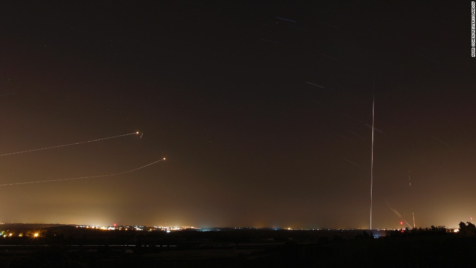"Missiles from Israel's Iron Dome defense system are fired to intercept rockets launched from Gaza before a five-day ceasefire was due to expire on Tuesday, August 19. <a href=""http://www.cnn.com/2014/08/15/world/gallery/week-in-photos-0815/index.html"">See last week in 29 photos</a>"
