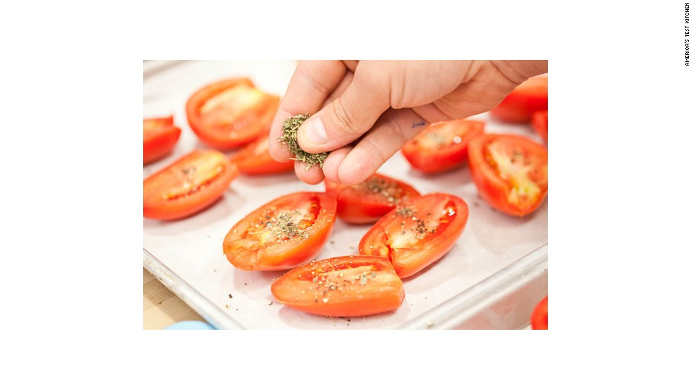 Season the tomatoes with Kosher salt, a lot of freshly cracked black pepper, and dried herbs de Provence. Thyme and oregano make good substitutions for the herbs de Provence (mint and rosemary do not); you can use fresh herbs, but dried work just fine.