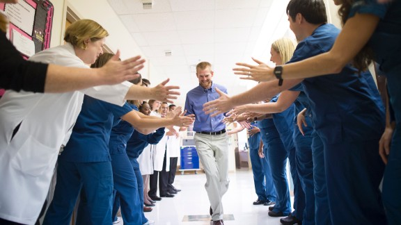 Dr. Kent Brantly leaves Emory University Hospital after being declared no longer infectious with the Ebola virus on Thursday, August 21.