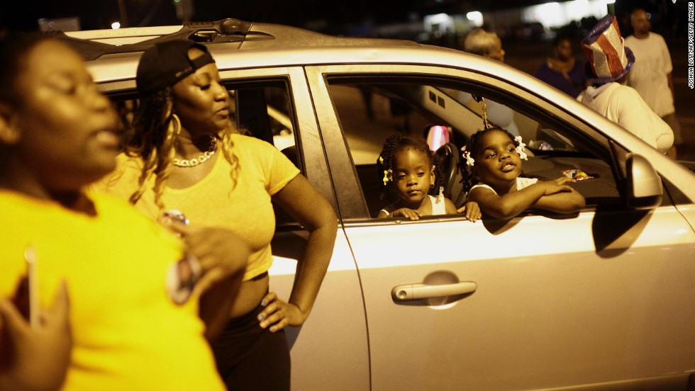 A crowd gathers in Ferguson on August 21, 2014. With the situation appearing to calm, Gov. Jay Nixon ordered the Missouri National Guard to begin withdrawing from the city.
