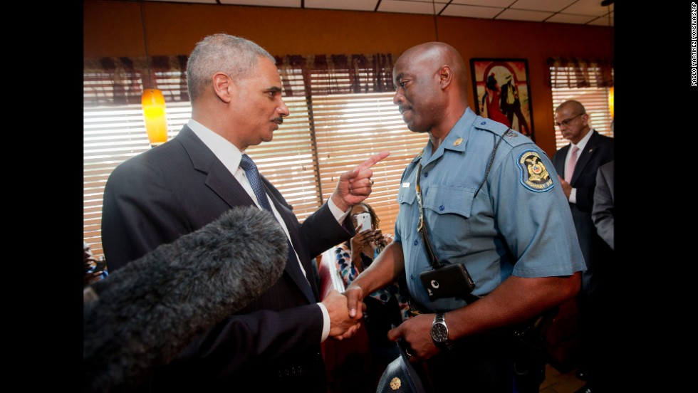 U.S. Attorney General Eric Holder meets with Capt. Ron Johnson of the Missouri State Highway Patrol at a Ferguson restaurant on August 20, 2014. Holder came to Missouri to talk to community leaders and review the federal civil rights investigation into Brown's shooting.