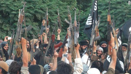 "ISIS celebrates announcement of their ""Caliphate."" Caption: 	This photo was tweeted from a Twitter account widely believed to belong to ISIS in Aleppo, Province, Syria. It purportedly shows celebrating ISIS' announcement of the so called Islamic Caliphate, spanning large areas of Iraq and Syria. The Islamic State in Iraq and Syria (ISIS) is a Sunni Muslim extremist group formerly linked to al-Qaeda-- al Qaeda has since denounced ISIS."