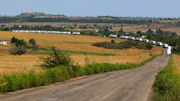 The first trucks of a Russian aid convoy roll on the main road to Luhansk in eastern Ukraine on Friday, August 22. The head of Ukraine