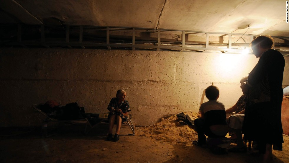 Locals of the community take refuge inside a cellar.
